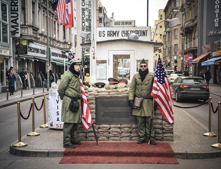 Soldiers at the famous Checkpoint Charlie in Berlin
